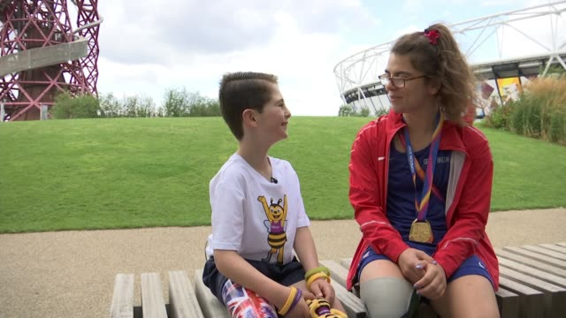 9yearold Rio Woolf meets gold medallist Sophie Kamlish ENGLAND London Stratford London Stadium EXT Rio Woolf and mother Juliette Woolf meeting Sophie...