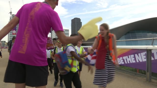 Sophie Kamlish wins gold medal ENGLAND London Stratford London Stadium EXT Various shots of children high fiving man wearing foam finger as arriving...