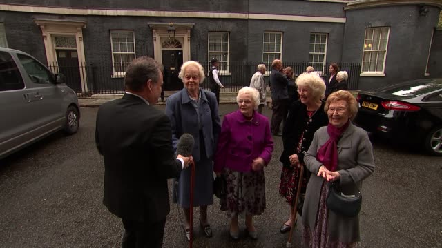 World War 'Canary Girls' who worked in munitions factories visit Downing Street London Downing Street EXT Elderly women from car and chatting with...