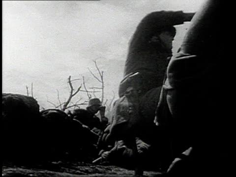 REENACTMENT World War I attack across No Man's Land through German machine gun firing / Western Front