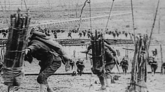 World War I military training including calisthenics marching parade formation and new soldiers marching off to war past civilians fluttering...