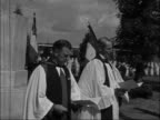 Anniversary of invasion of Normandy commemorated FRANCE Ranville GV Beach CU Signpost 'RANVILLE' CU Cross over cemetery Ceremony Clergy conducting...