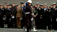 World War One Centenary Armistice Day commemorations Cenotaph ceremony Cenotaph as piper plays SOT / Man reading 'Ode of Remembrance' SOT / Bugler...