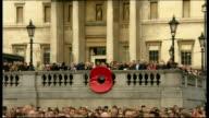 World War One Centenary Armistice Day commemorations Trafalgar Square ENGLAND London Trafalgar Square EXT GVs crowd above square while last post...