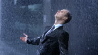 Worried Businessman In The Rain