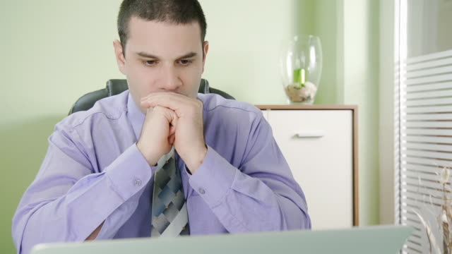 HD DOLLY: Worried Businessman Looking At Laptop