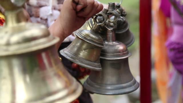 Worshipper ringing bells