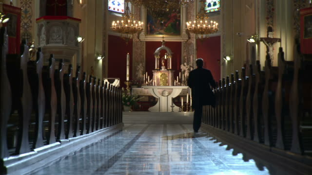 HD DOLLY: Worshipper Walking Out Of Church
