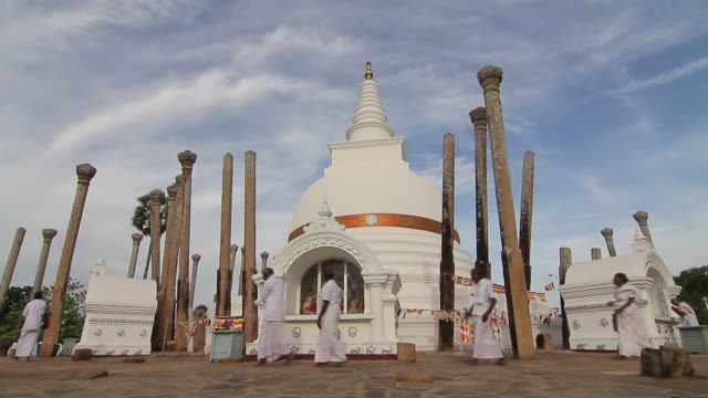 MS T/L Worshippers circle Thuparama Dagoba, first dagaba built in Sri Lanka after introduction of Buddhism, contains collarbone of Buddha / Anuradhapura, North Central Province, Sri Lanka