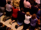 Worshippers kneel and pray in Catholic church Basque Country Spain