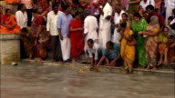 Worshippers wash in the Ganges River. Available in HD.