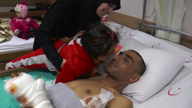 Wounded Syrian Mustafa Rashid meets with his daughters at a hospital in Adana Turkey on December 30 2016 Mustafa Rashid lost his legs in East Aleppo...