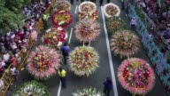 Wreaths decorated with more than 50 varieties of flowers were carried by hundreds of people parading Monday in Medellin to celebrate the 60th...