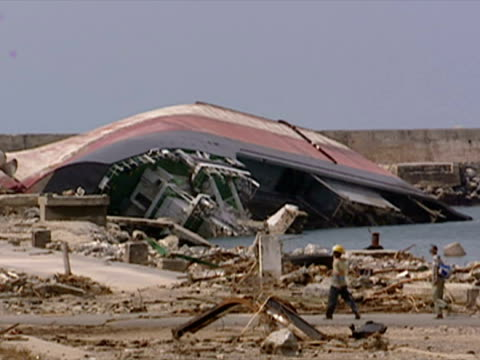 Wrecked ship upside down in harbour after Earthquake and Tsunami in Indonesia