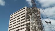 WS Wrecking ball demolishing building / Chicago, Illinois, USA