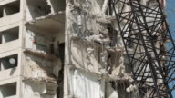 MS TU Wrecking ball demolishing building / Chicago, Illinois, USA