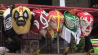 CU Wrestling masks hanging on market stall, San Diego, California, USA