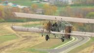 CU TS Wright B Flyer airplane flying over trees and propeller / Dayton, Ohio, United States