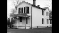 Wright brothers house on Hawthorne Street in Dayton Ohio / Carrie Grumbach former housekeeper seated at a desk / she explains 'I remember the...