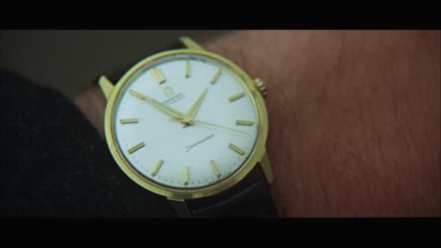 1966 CU Wrist watch on person's wrist