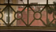 Wrought iron circles and squares feature in a railing. Available in HD.