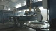 WS_Man operating big stone cutting machine