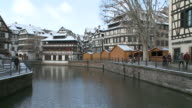 WSPeople walking on small strret near river / Strasbourg, Alsace, France