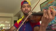 Wuilly Arteaga the ever present violinist in Venezuela's deadly demonstrations is unable to tell his former fellow prison inmates that the street...