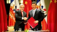 Xi Jinping and Chilean Foreign Minister Alfredo Moreno review a guard of honour upon his arrival at La Moneda Palace VAR of Xi and Chilean President...