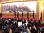 Xi Jinping and his team wave after being chosen by the 18th Communist Party Congress to be China's next generation of leaders