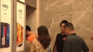 Xiaomi employees and guests enter the reception area at Xiaomi headquarters in Beijing China on June 3 Xiaomicom signage and posters