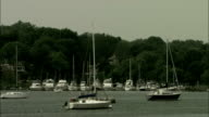 Yachts anchored on a lake. Available in HD.