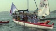 Yachts and fishing boats converge on Rios filthy Guanabara Bay the site of next years Olympic sailing contests to protest the authorities failure to...