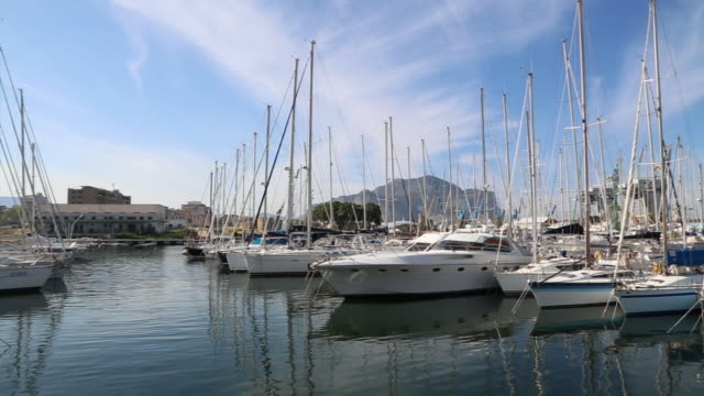 Yachts and ships in the marine, in the port of Palermo, Sicily.