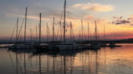 Yachts at the port of Syracuse, Sicily at sunset.