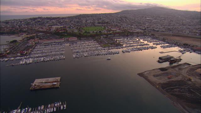 AERIAL Yachts moored at Long Beach marina at sunset, Long Beach, California, USA