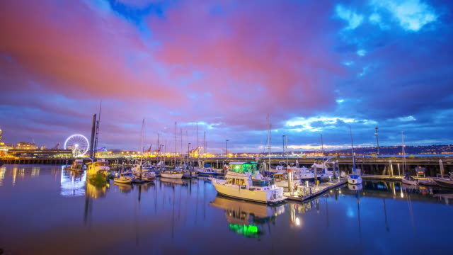 yachts,water and colorful sky. timelapse