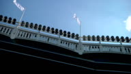 Yankee Stadium frieze roof w/ flags ballpark lights clear blue sky BG NYC NY Yankees Bronx Bombers MLB baseball