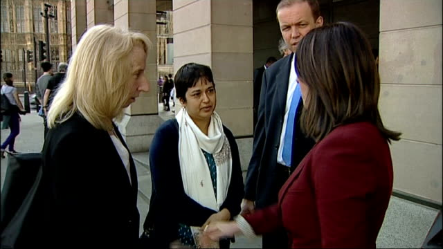 Yashika Bageerathi deportation appeal rejected ENGLAND London Westminster EXT Sowbhagyawatee Bageerathi stands talking with others outside Portcullis...