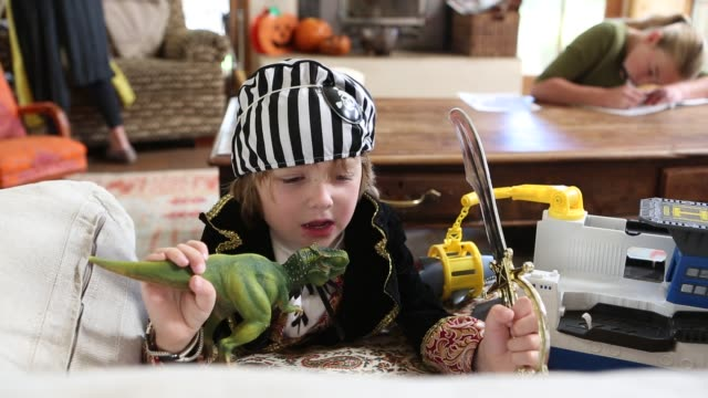 4 year old boy dressed as a pirate at home