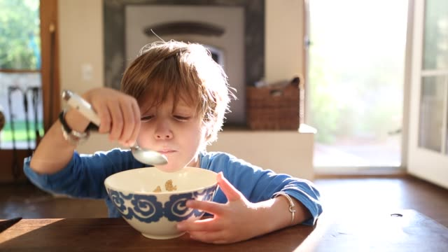 4 year old boy eating cereal