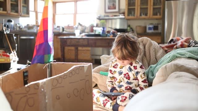 4 year old boy on sofa