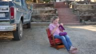 10 year old girl knitting outdoors