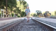 11 year old girl on railroad tracks