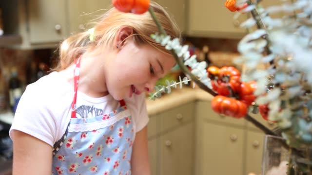 9 year old girl stirring cake batter