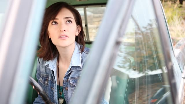 25 year old woman sitting in 1973 pick up truck