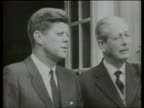 30 Year Rule Papers Opened 1963 Pres John F Kennedy out TX 21463 building with then UK PM Harold ITN Macmillan B/W CMS SLOMO both standing chatting...