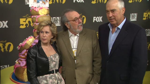 Yeardley Smith and James L Brooks at The Simpsons 500th Episode Celebration On The Yellow Carpet in Hollywood CA on 2/13/12