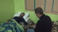 25 yearold Syrian Mohamed Abo bedridden for three years after wounded in air attacks of Assad regime yearns for the days which he will be able to...