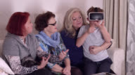 9 years old boy teaches grand mother, 90 years old great grandmother and a 70 years old lady how to use VR glasses